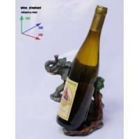 Подставка для бутылки, слон и бутылка.
